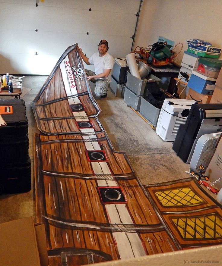 "Constructing two large cardboard pirate ship props ""Corena"" and Sea Hag"" for a 2015 Halloween project."