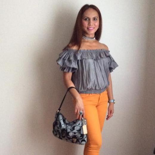 half shoulder blouse with orange pants