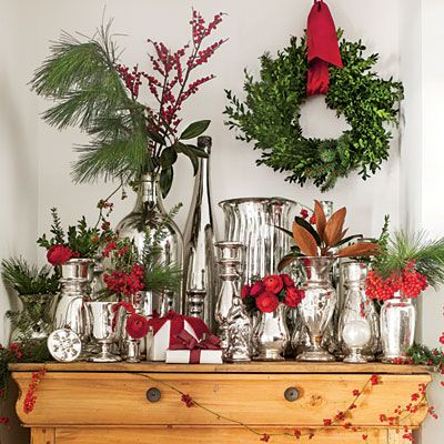 Accent a Collection-Look for out-of-the-way display areas, such as the top of a chest, to add sparkle and shine. Whether your vignette stays up year-round—like this collection of mercury glass—or is seasonal, keep the fluffing simple so it doesn't compete. Just cut appropriate lengths of fresh magnolia, boxwood, pine, fir, winterberry, and American cranberry bush berries to fit vessels.