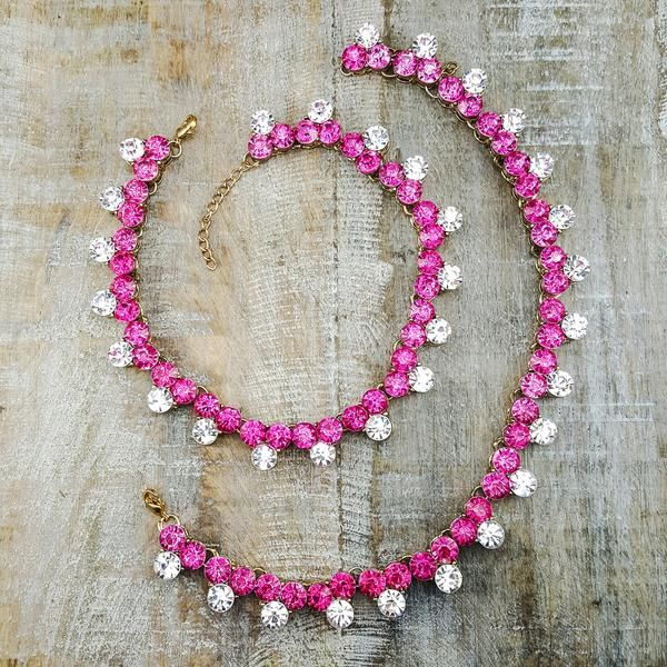 Gina - Completely covered with both fuchsia and clear stones, these Anklets are sure to make a statement.