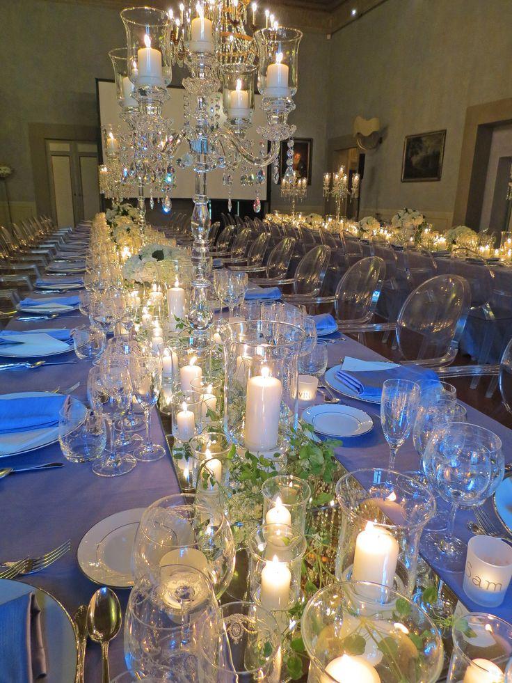 Cristal candelabra, glass flambeaux, candles, mirror and flowers. Event Planner : Monica Balli