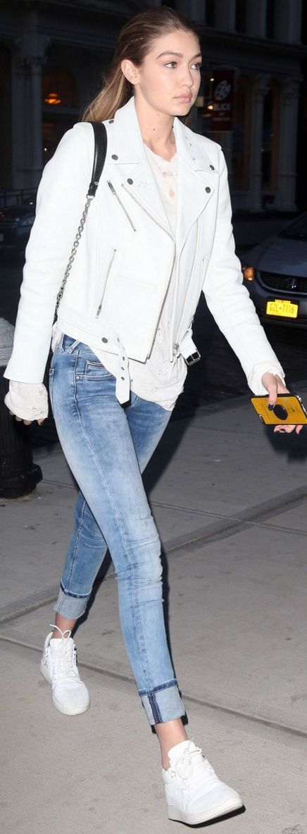Gigi Hadid: Purse – Louis Vuitton  Jacket – Neuw  Jeans – Tommy Hillfiger  Shoes – Giuseppe Zanotti