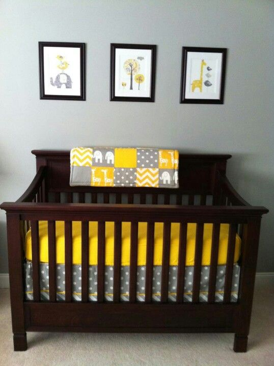 Adorable yellow and gray nursery with elephants and giraffes