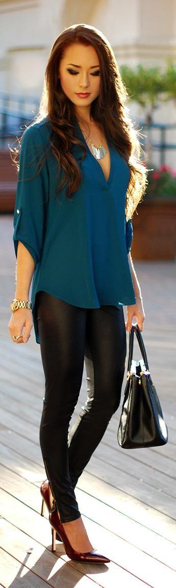 three quarter sleeve dark teal top with black leather leggings, black heels, and black bag