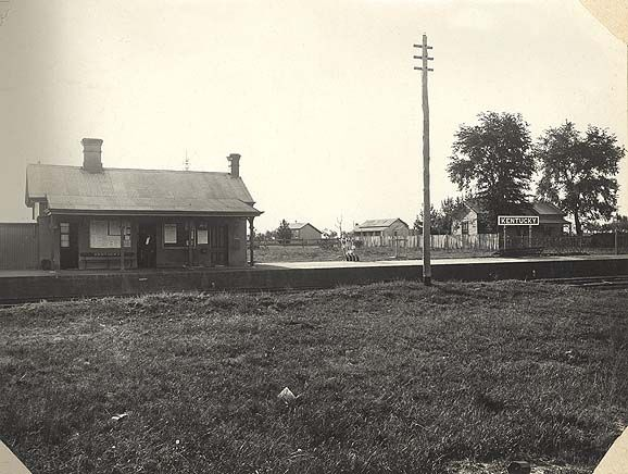 Image | [Kentucky Soldiers' Settlement Estate - railway station with school building in background][Kentucky Soldiers' Settlement Estate - railway station with school building in background][Kentucky Soldiers' Settlement Estate - railway station with school building in background]
