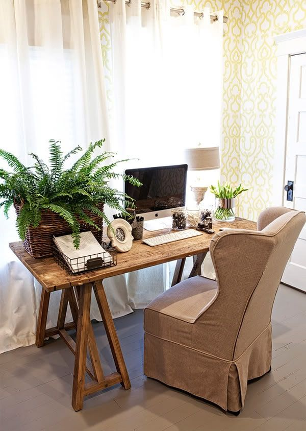 simple rustic in home office, love the cozy chair & that fern!