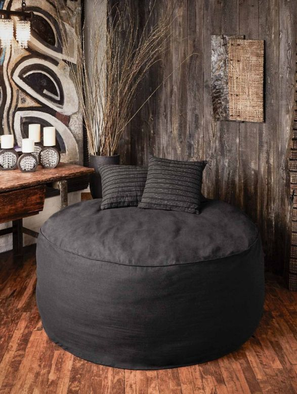 Luxurious Balinese pouf filled with Kapok, a cotton-like fluffy material obtained from Ceiba trees. Extremely comfortable and plush, this lounging pouf can be used indoors or outdoors.