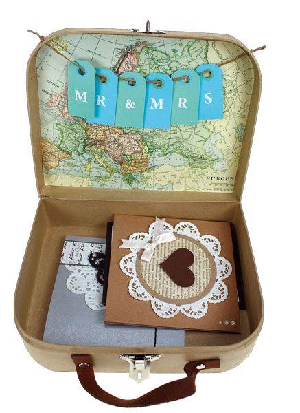 Pienestä pahvisesta matkalaukusta voi koristella häälahjapöytään rasian korteille. Tarvikkeet ja ideat Sinellistä!