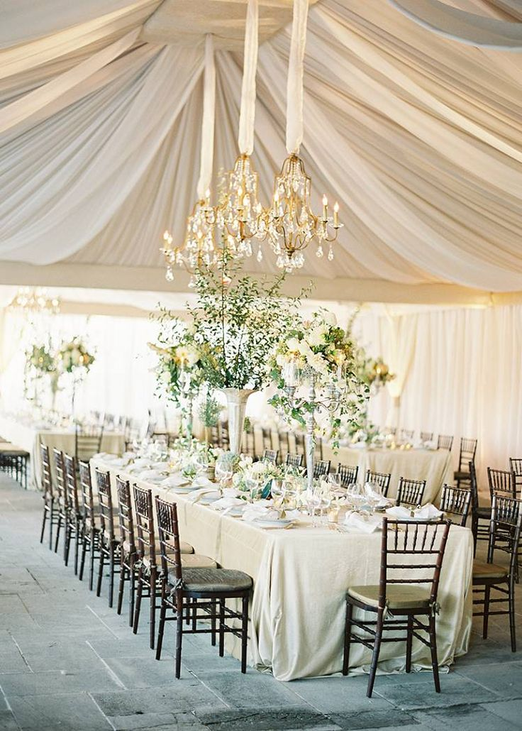 Draped Tent with Chandeliers designed by Easton Events - Destination Wedding Planners with offices in Charleston, SC and Charlottesville, VA photo by Jose Villa