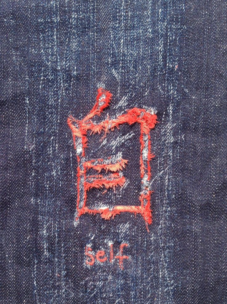 """Self"" unravelled embroidery on organic 14 oz. denim"