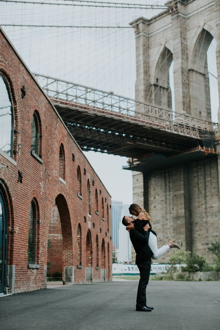 New York City Engagement photo idea - couple poses in the city {Courtesy of Forever Photography}