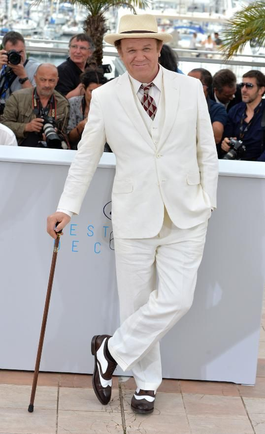 Dapper dude! John C. Reilly looked straight out of another, more sophisticated decade, in a white three-piece suit, geometric red and gray tie, fedora, oxford shoes, and a cane.