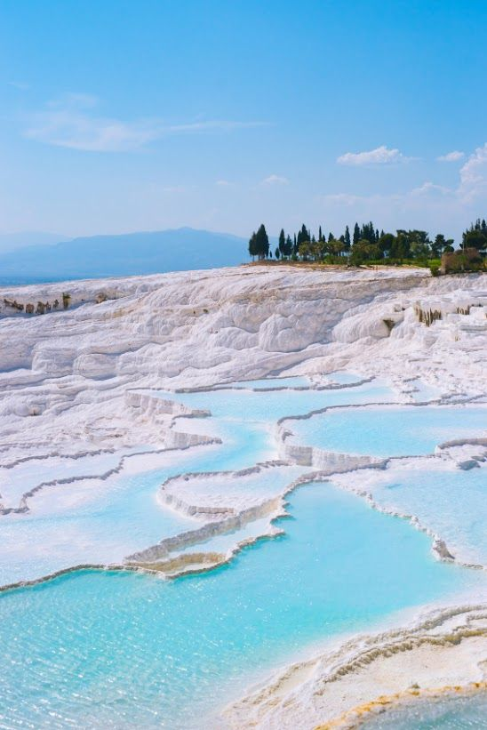 Pamukkale, Turkey These thermal springs in the cliffs, the naturally occurring terraced basins of Pamukkale (meaning Cotton Palace) have long attracted visitors. The thermal spa of Hierapolis was founded at the site in second century BC, offering today's visitors not only a chance to marvel at the natural geological formations created by the calcite-laden waters but also the a chance to marvel at the ruins of the once-great baths. It was declared a World Heritage Site in 1998.