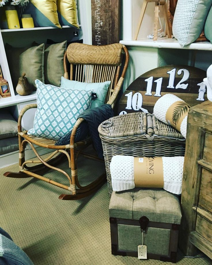 Every #nookandcranny is full of #newseason #goodies at #theminerscouch @madraslink #noosaliving #woodlandframes #homestyling #rockingchair #cane #laundryhamper #woodclock