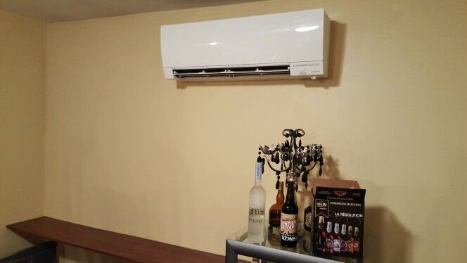 Mitsubishi ductless whisper quiet indoor wall- mount unit installed by Compass Heating and Air Conditioning, Inc. in Hoffman Estates, IL.
