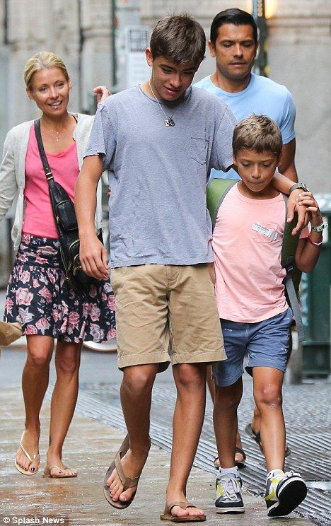 Kelly Ripa enjoys an afternoon stroll with her husband Mark Consuelos and their two growing sons Michael and Joaquin
