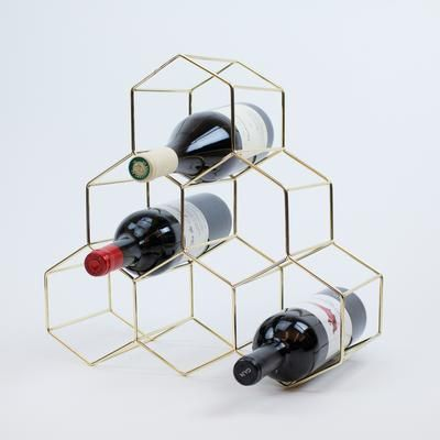 Modern and functional, this stylish wine rack is perfect for any table or counter top. We love the mid-century modern look of the rack along with its sleek design.
