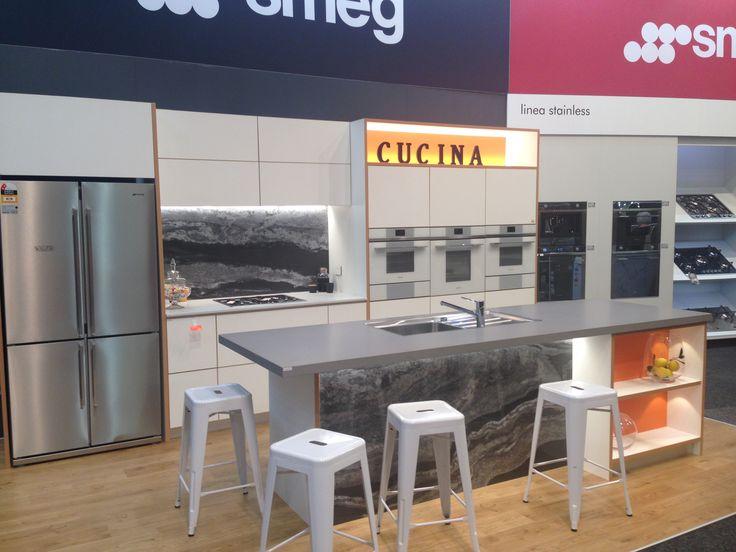 Innovative Kitchens display kitchen by John Van Doormal featuring Caesarstone Sleek Concrete, Caesarstone Fresh Concrete and Melteca Snowdrift in Puregrain finish