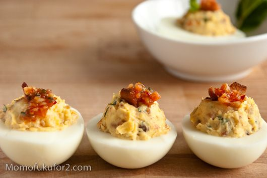 Kimchi Bacon Deviled Eggs. I am generally not a big fan of deviled eggs but this is making me want to give them another try.
