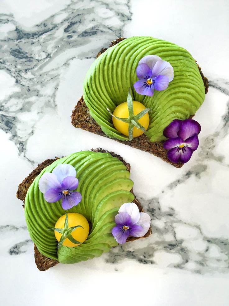 Avocado toast, cherry tomatoes and edible flowers