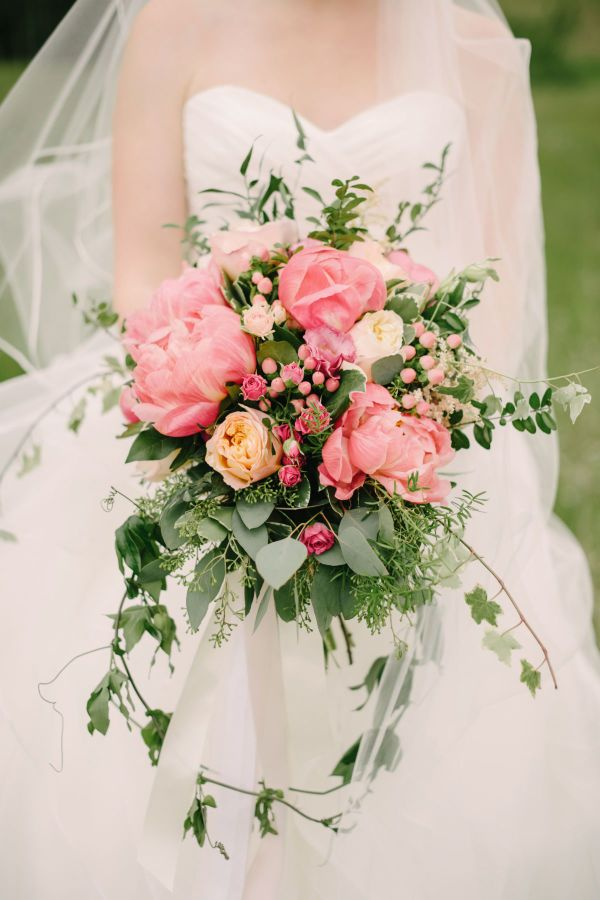 Overflowing coral charm peony bouquet: http://www.stylemepretty.com/canada-weddings/alberta/2016/02/12/pink-woodland-fairytale-mountain-wedding/ | Photography: Corinna Walker - http://www.corrinawalker.com/