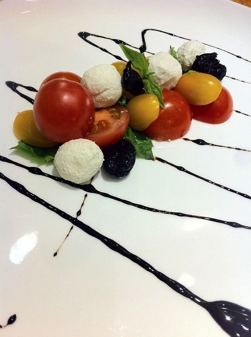 CAPRESE. macadamia mozzarella. balsamic reduction. sun-dried olives.