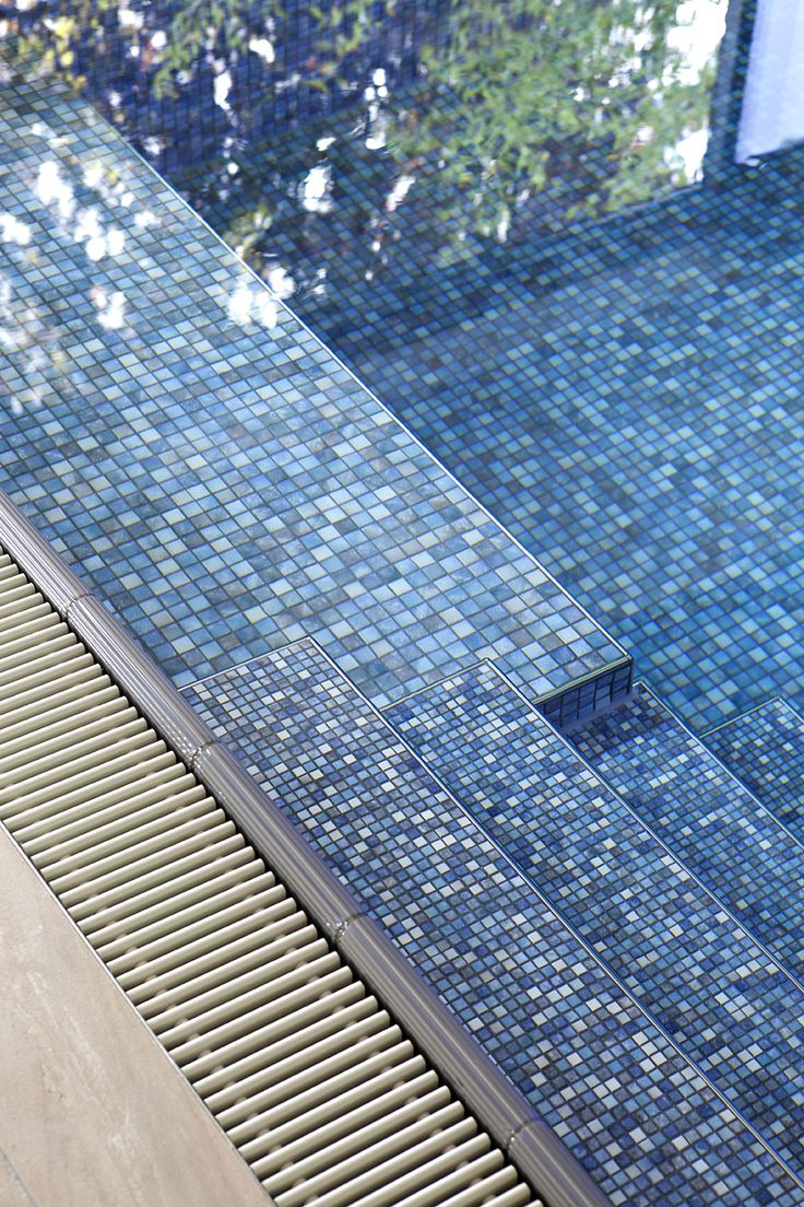 Slip resistant mosaic tiles leading into pool. Mosaics are part of Jasba pool tile range.