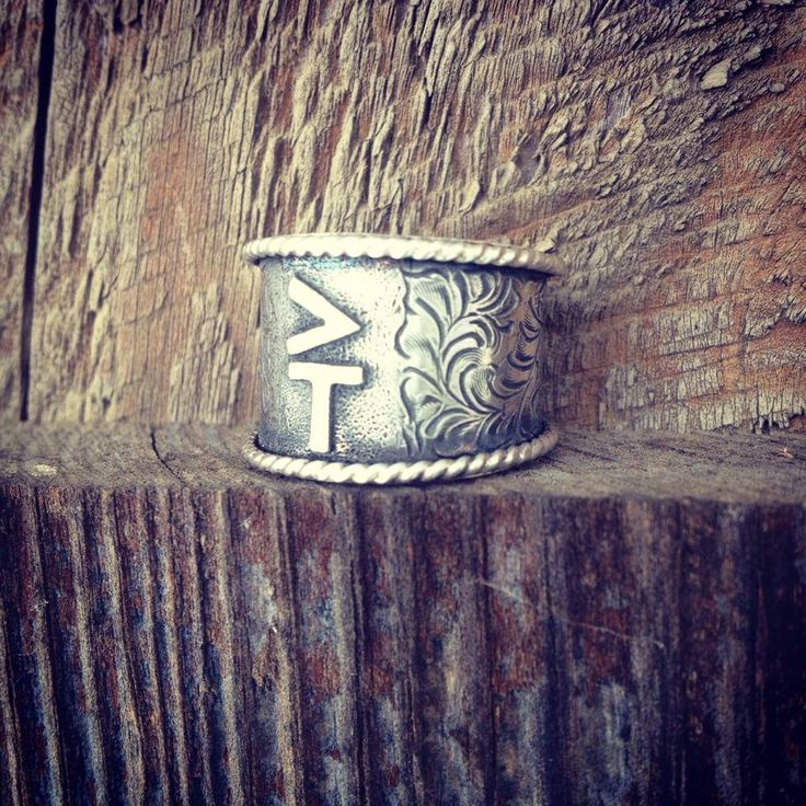 By Silo Silver . Go check out their Facebook page, they have awesome jewelry with custom cattle brands. Love !