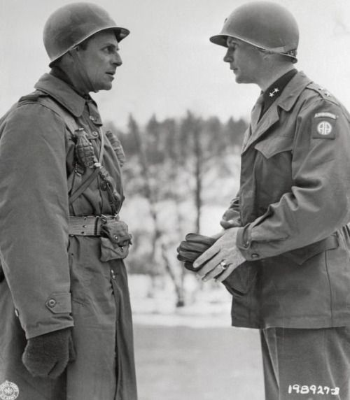 Major General Matthew B. Ridgway, Commanding General of the 18th Airborne Corps, and Major General James M. Gavin, Commanding General, 82nd Airborne Division, talking together before an award ceremony in Belgium. March 26, 1945.