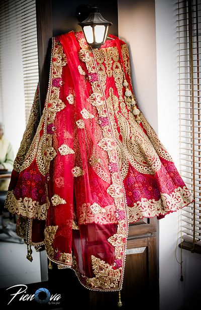 Bridal Lehengas - Red and Gold Bridal Lehenga with Golden Embroidery and Threadwork and Red Net Dupatta | WedMeGood  #wedmegood #indianlehenga #indianbride #red #net #threadwork