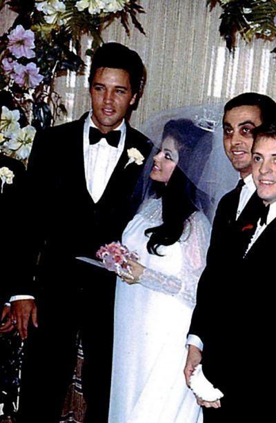 Priscilla Presley and Elvis Presley on their wedding day.
