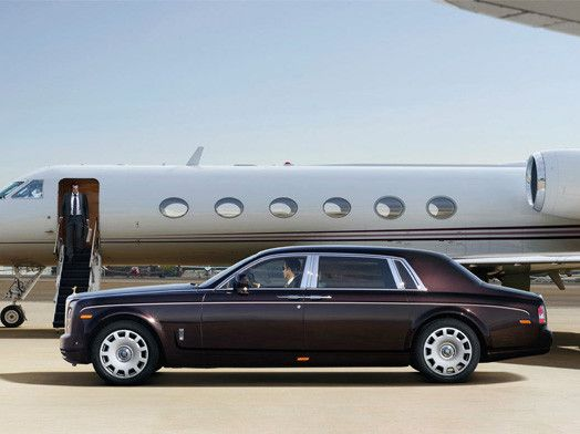 Ultimate Luxury: Rolls Royce Phantom in front of a Gulfstream G650.