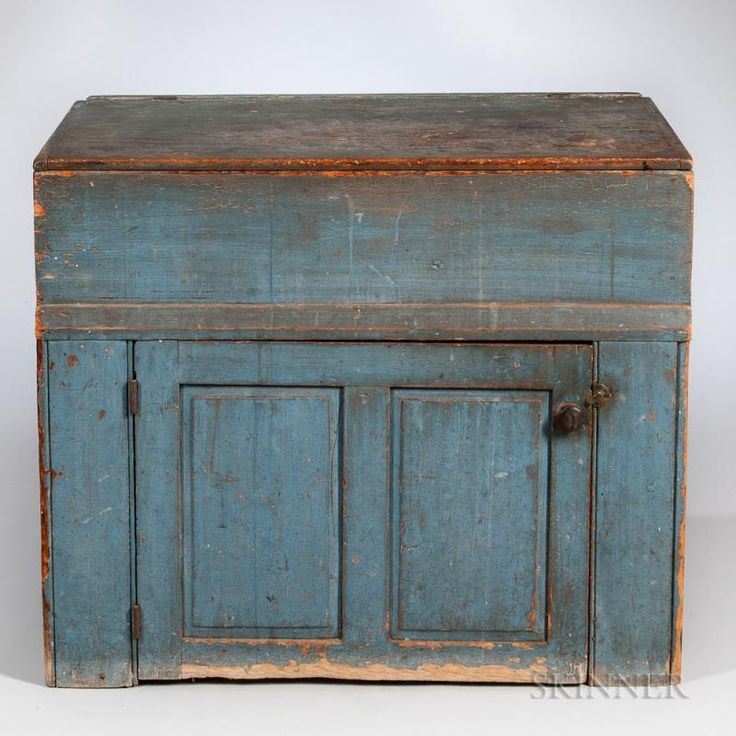 Blue-painted Pine Lidded Dry Sink, New England, 19th century, the lift top with breadboard ends opens above a well, all above a wide double-paneled door, ht. 33 3/4, wd. 40, dp. 22 in.