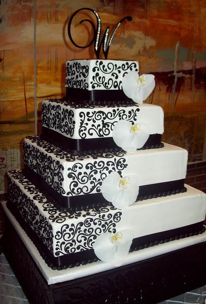 Black and White Square Wedding Cake with Orchids. Red roses would be better than the orchids :)