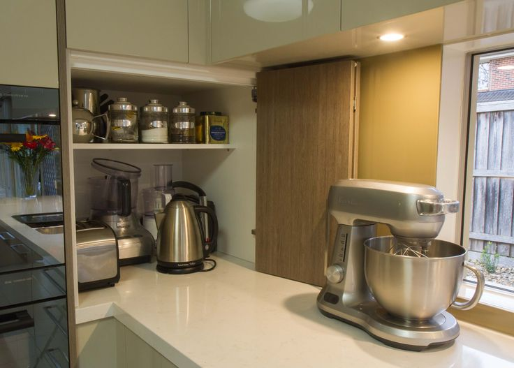 Stunning contemporary kitchen with window splashback and island bench. A corner appliance pantry allows for smart storage. www.thekitchendesigncentre.com.au @thekitchen_designcentre
