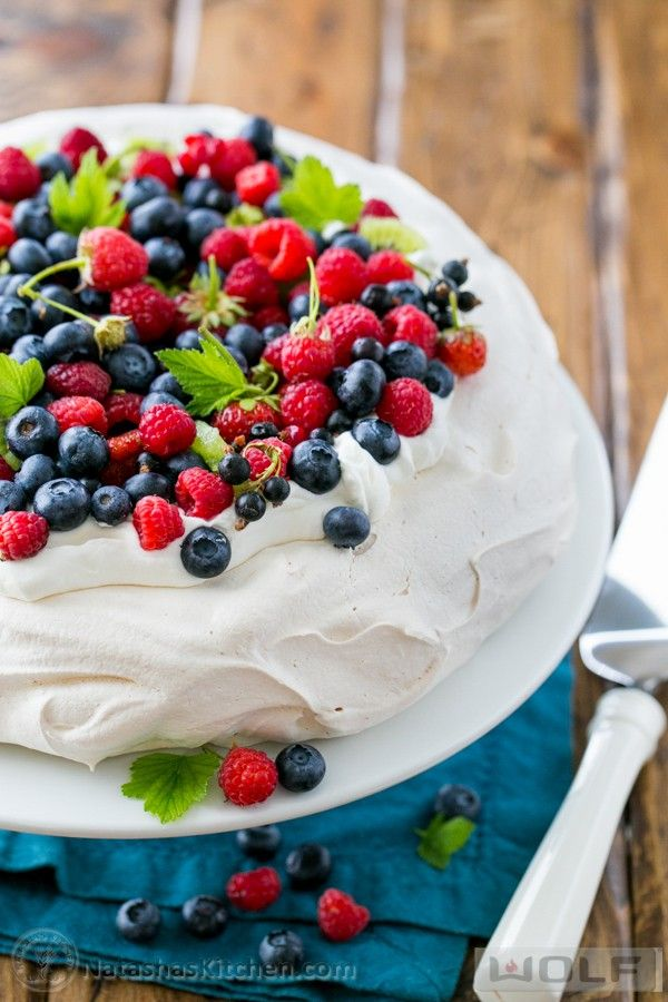 A must try loaded berry pavlova. It's light, airy and filled with all the best summer berries. It is crisp on the outside and marshmallowy soft inside.