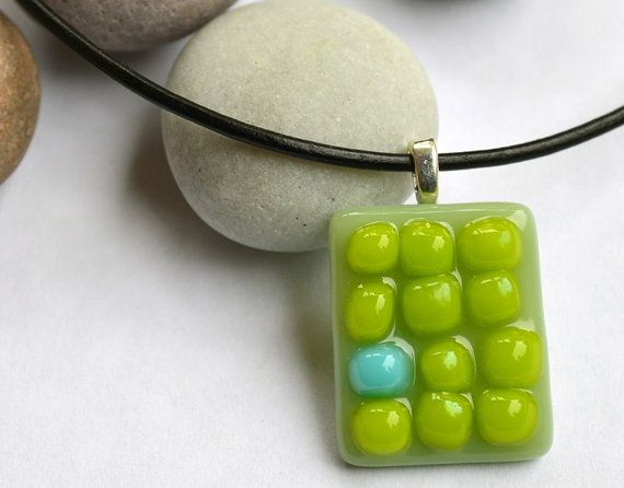 Fused glass necklace on leather cord, green and turquoise dots