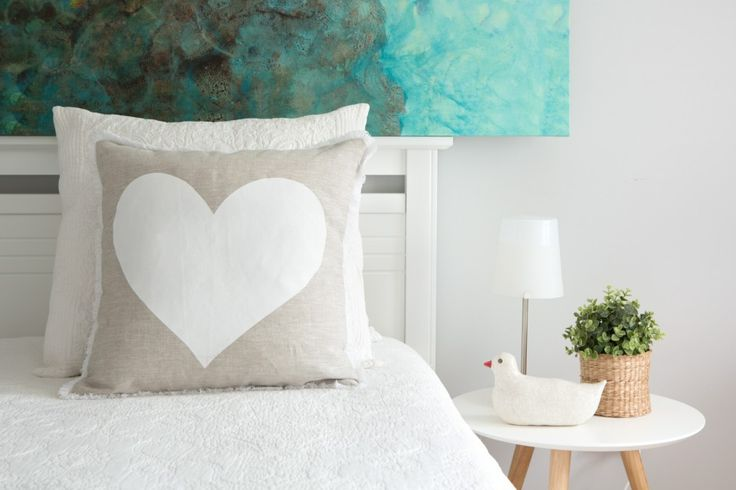 I love this bedroom shot, the colours are so relaxing, yet it is bright and happy and simple..finished off with love...