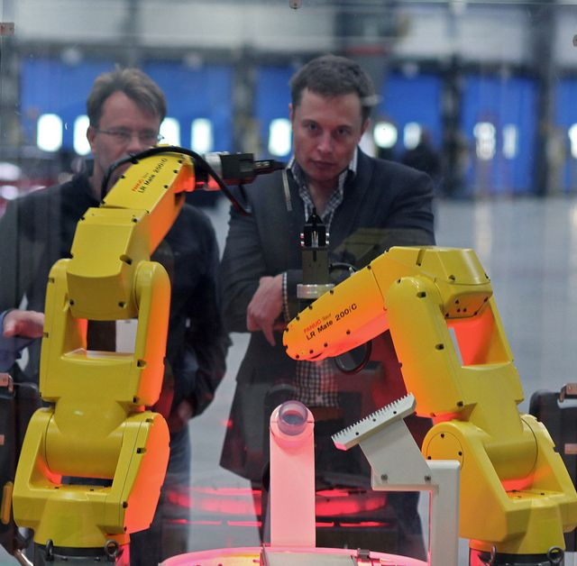 A demonstration of FANUC robot arms for Elon Musk.