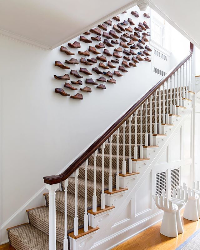 This stair inspiration started when I stumbled upon a giant box filled with dusty and abandoned vintage wooden shoe molds while antique shopping at #hpmkt. It took a carpenter three days and over 300 nails to secure these to this stairwell, but the result was well worth it. Stay tuned for a full home tour of this beautiful Litchfield, CT estate completed in the Fall of 2014. {Tap on image for sources & please visit our website for project and photo credits.} #ChangoAndCoLitchfieldHouse