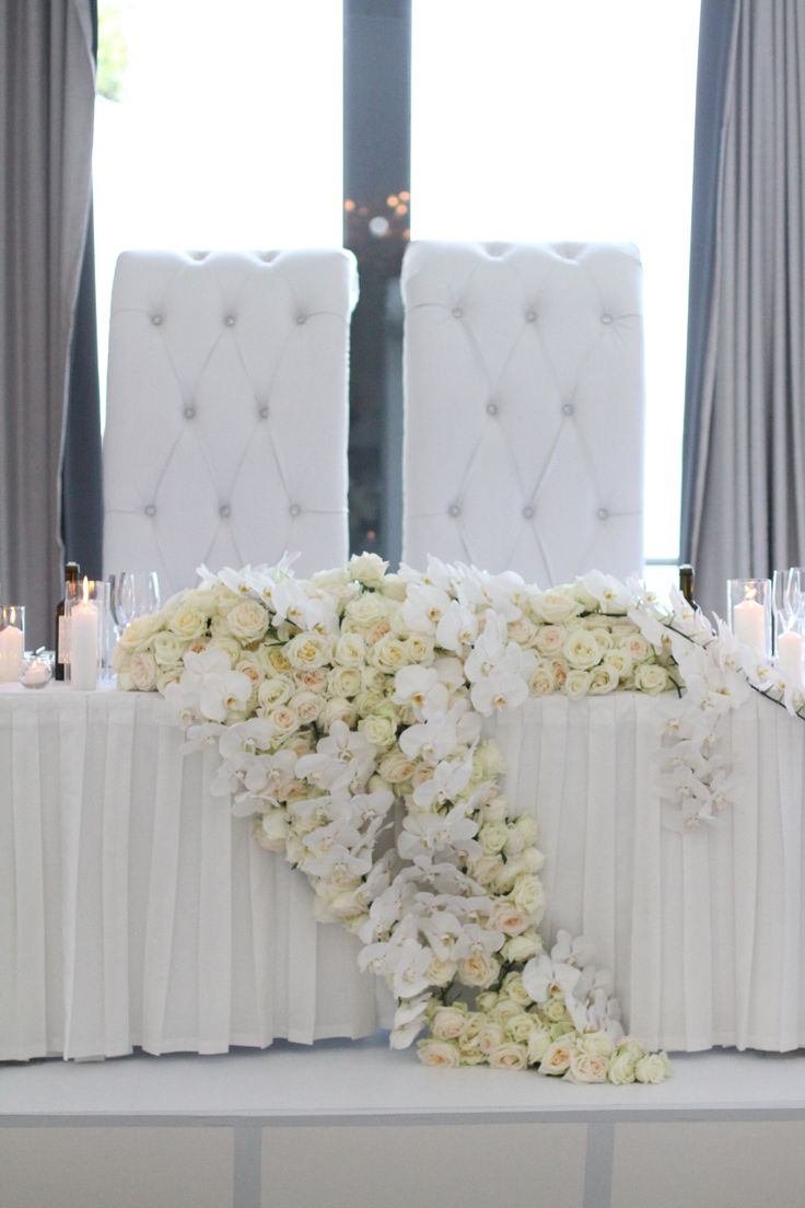 Luxe cascading bridal table design by Zinnia Floral Designs.