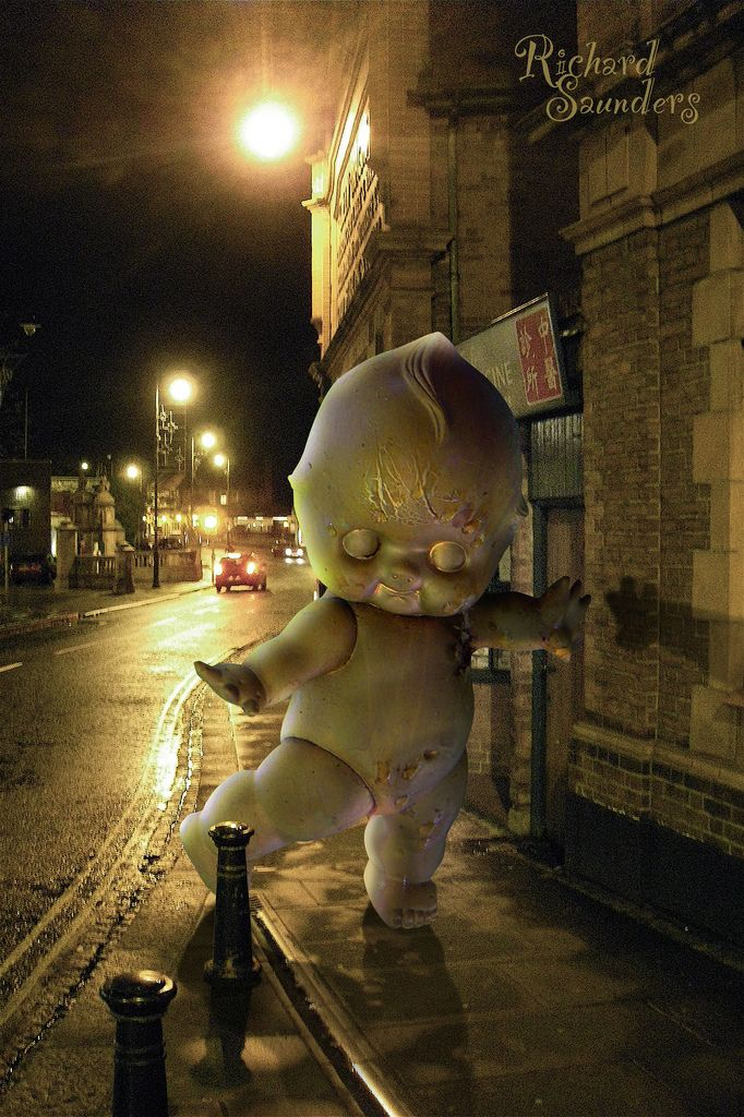 Both these photographs were taken some time ago. It only occurred to me recently that this much distressed Kewpie doll, which I had sprayed gold and had been hanging in a tree in our garden for some time, would sit well in this photo of Hertford town.