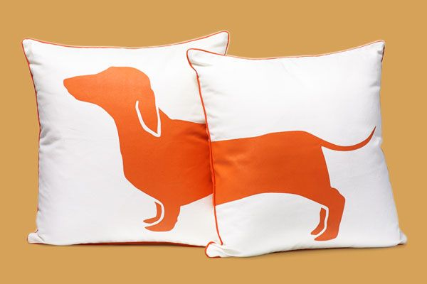 two throw pillows that together form the image of a single dachshund, how to create a laid-back living room