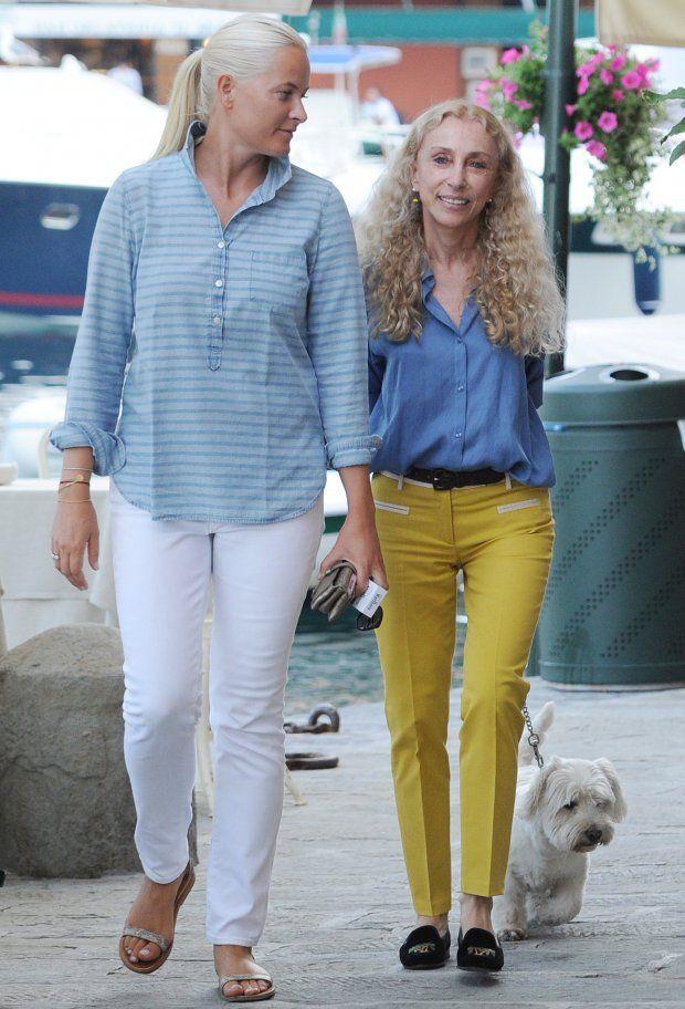 Crown Princess of Norway Mette Marit walks in Portofino with her friend Franca Sozzani