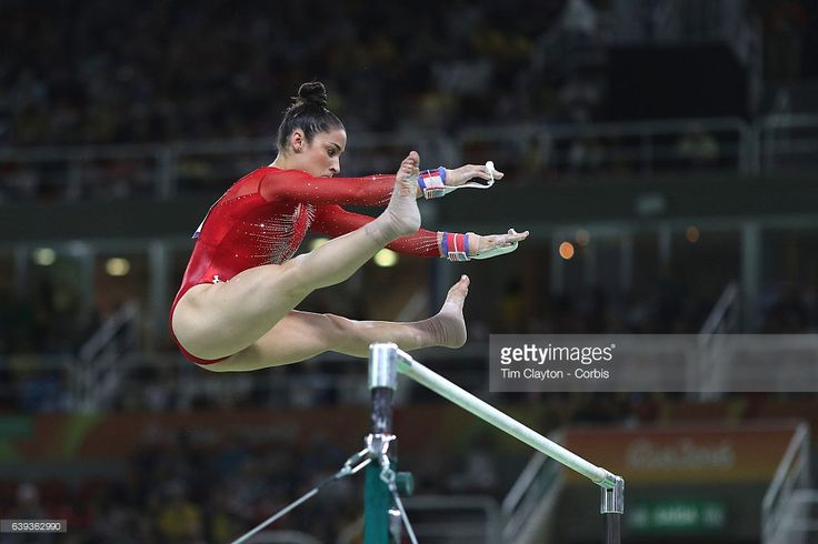 Day 6 Alexandra Raisman #395 of the United States in action on the Uneven Bars during her silver medal performance in the Artistic Gymnastics Women's Individual All-Around Final at the Rio Olympic Arena on August 11, 2016 in Rio de Janeiro, Brazil.