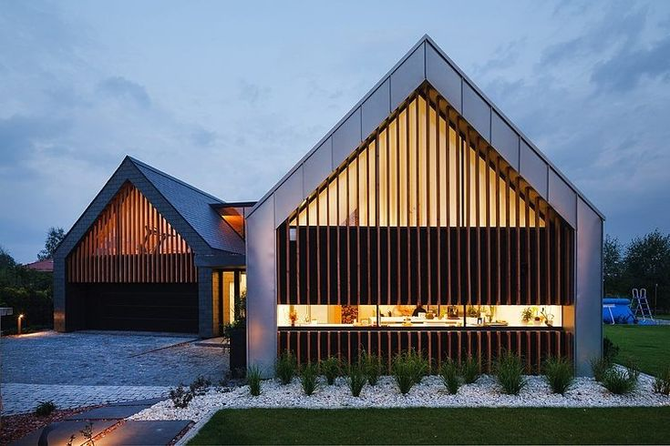 Two Barns House Designed by Robert Skitek of RS+,  located in a quiet northern district of Tychy, Poland.