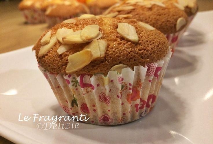 Muffin+agli+agrumi+con+mandorle+a+scaglie