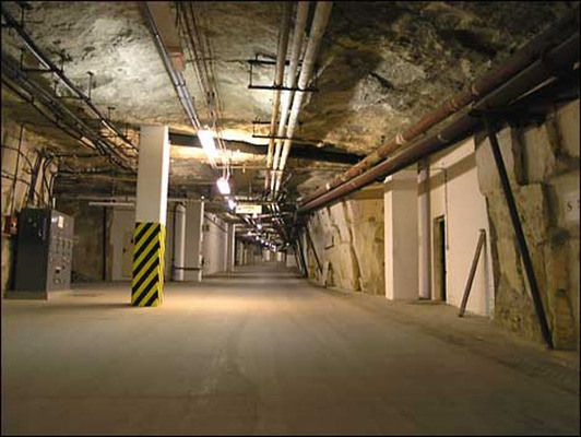"""under a charming sleepy market town known as Corsham, Wiltshire... is a 35-acre subterranean """"Cold War City."""" The reason this particular location was chosen for the bunker was its already-extensive system of limestone caves running under the city."""