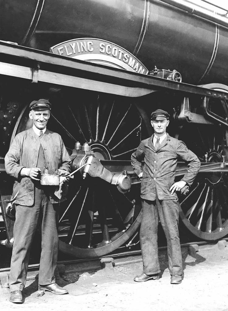 King's Cross Station in London. It shows the driver, Bill Sparshatt (left), and his fireman, R Webster. The picture was taken on the day of the record-breaking 100-mph run between London and Leeds. 30 November 1934