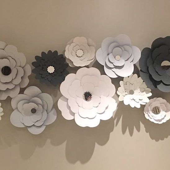 Another new favorite! Our 1.8m wide Flower feature wall design... finished off with elegant mirror centers.  Available in different colour options.  #homedecor #family #interiors #featurewall #floraldecor #flowerwall #paperflowers